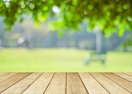 wood products: Perspective wood over blur trees with bokeh background, spring and summer season Stock Photo