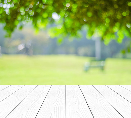 page background: Perspective white wood over blur trees with bokeh background, spring and summer season