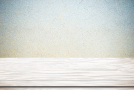 Empty white table over grunge cement wall, vintage, background, template, display