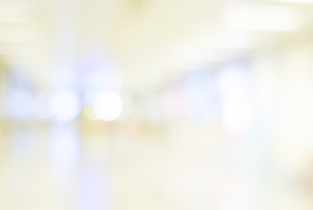 blurry: Blur inside office building with bokeh light background, interior and business background