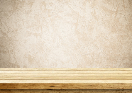 Empty wooden table over cement wall background