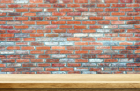 grunge wallpaper: Empty wooden table over brick wall background