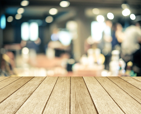 bar counters: Perspective wood over blurred restaurant with bokeh background, foods and drinks, product display montage Stock Photo