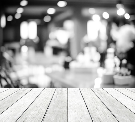 drinks on bar: Perspective wood over blurred restaurant with bokeh background, foods and drinks, product display montage, black and white tone