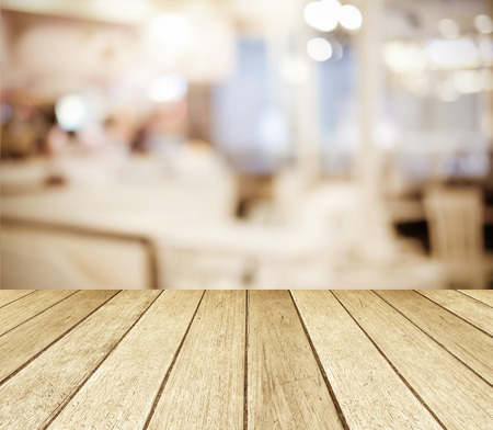 in perspective: Perspective wood over blurred restaurant with bokeh background, foods and drinks, product display montage Stock Photo