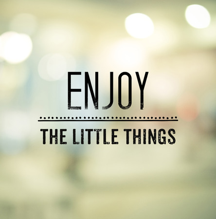 mindful: Enjoy The Little Things, inspriration quote, on blur bokeh light background
