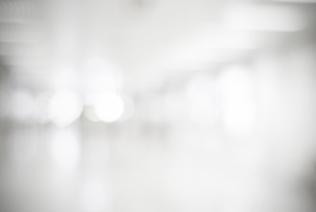 Blur inside office building with bokeh light background, interior and business background