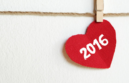 love message: Red fabric heart with  2016 word hanging on the clothesline, new year template Stock Photo