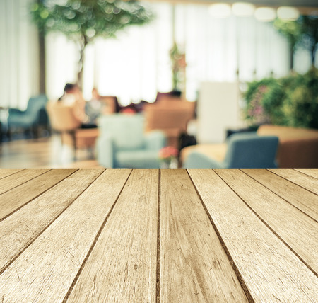 Perspective wood over blurred restaurant with bokeh background, foods and drinks, product display montage Standard-Bild