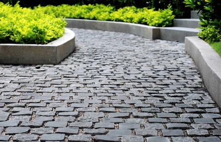 piso piedra: pavimento de piedra en el parque, fondo.