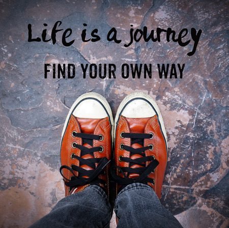 find your way: Life is a journey, Find your own way, Inspiration quote, shoes on pavement Stock Photo