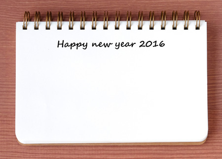 blank note book: Happy new year 2016 words on blank note book background Stock Photo