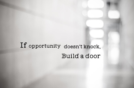 Inspirational quotation, If opportunity doesn't knock , Build a door, positive thinking inspiration Фото со стока