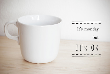 cup: Inspirational quote on coffee cup background with vintage filtered