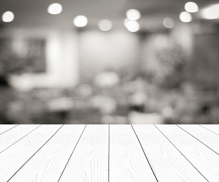 empty shelf: Perspective wood and blurred cafe with bokeh light background. product display template Stock Photo