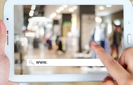 electronic store: On line shopping on tablet screen, business, E-commerce, technology and digital marketing background
