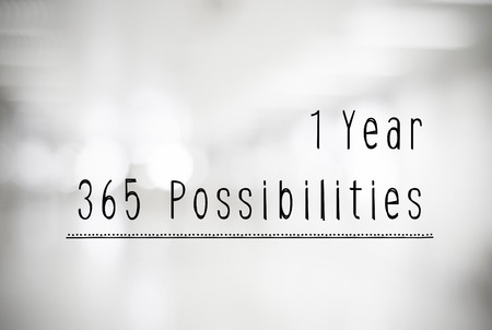 possibilities: 1 year 365 possibilities quotation on black and white abtract blur background