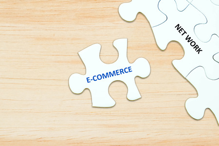 redes de mercadeo: E-commerce and network words on jigsaw puzzle background, digital marketing, success in business concept Foto de archivo