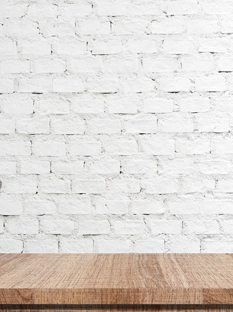 table: Empty wooden table over white brick wall background