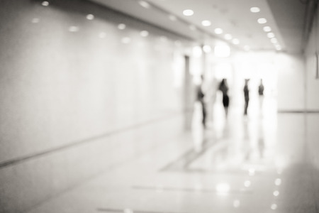 Blur inside office building with people and bokeh light background, interior and business background