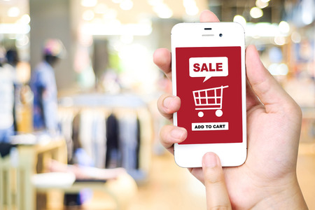 sale shop: Sale and shopping on line concept on smart phone screen over blur store background, e-commerce, business and technology concept