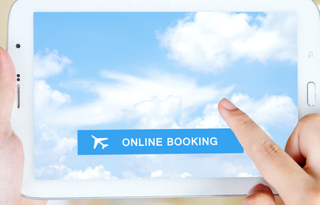 airplane ticket: Airline tickets online booking on tablet screen over blue sky background, Business air travel, e-commerce and digital technology concept Stock Photo