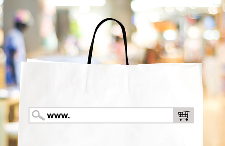 Word www. on search bar over shopping bag and blur store background, online shopping background, business, E-commerce, web banner Foto de archivo