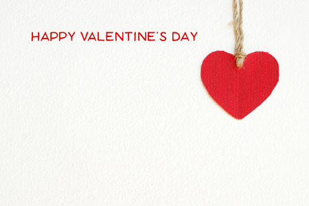 the red line: Happy valentines day and red fabric heart shape hanging on cloth line background with copy space