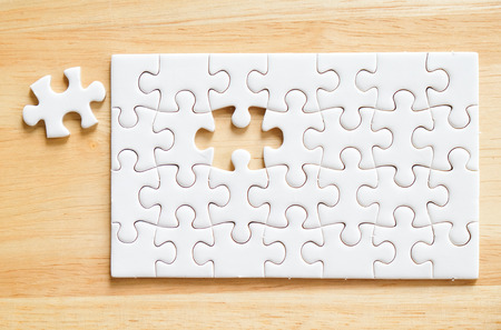 puzzle background: Jigsaw puzzle on wood, background, business concept, flat lay Stock Photo