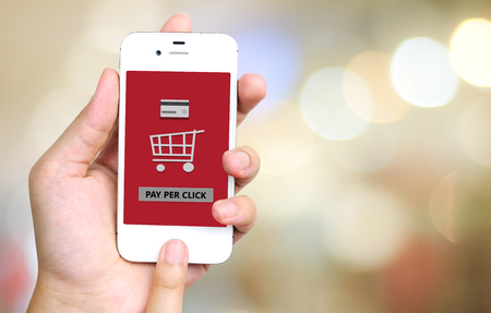 pay phone: Pay per click on smart phone screen, technology and business concept