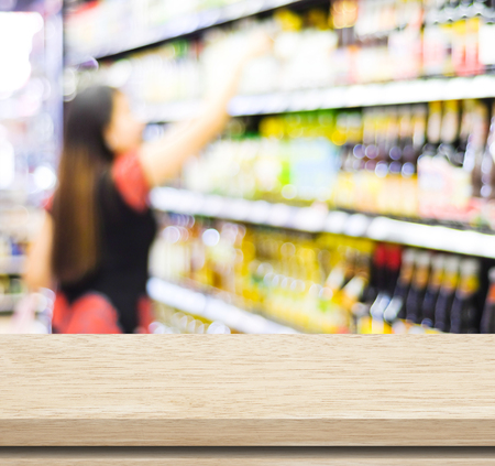 store shelf: Empty table over blur supermarket with bokeh background Stock Photo