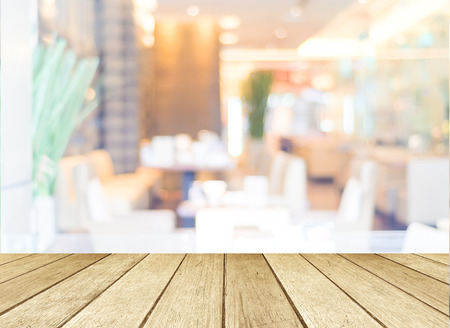 table decorations: Perspective wood and blurred cafe with bokeh light background, product display montage