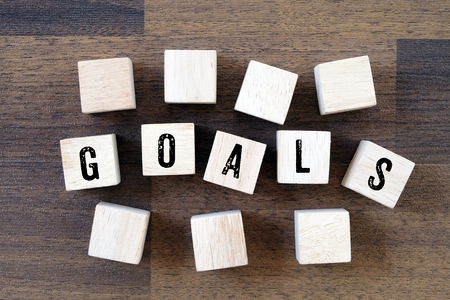 success concept: Goals word on wooden cubes, success in business concept Stock Photo