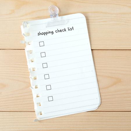 Lista di controllo di acquisto su carta bianca, sfondo, affari