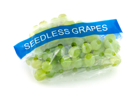 seedless: Seedless grapes in plastic bag isolated on white background.
