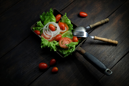 Mix vegetable salad in pan on dark background, clean food  concept