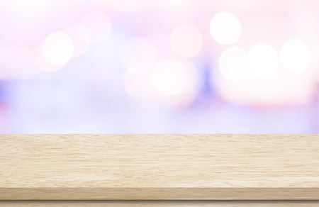 montage: Empty wooden deck table over blur festive bokeh background, for product montage