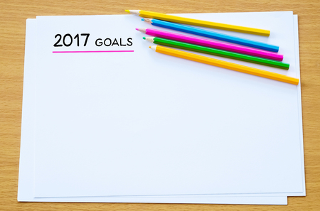 2017 goals on blank note book background, new year resolutions concept