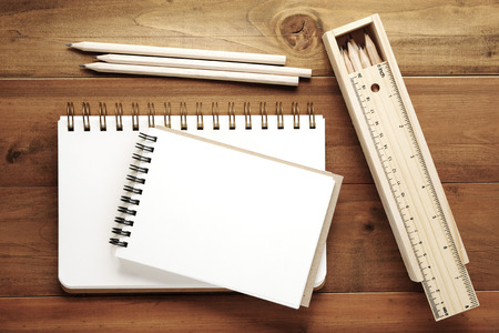 note books: Blank note books ,pencils ,ruler and pencil box on wood background, template with copy space for text