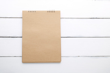 blank note: Blank recycle paper notebook on vintage white wood background with copy space for text