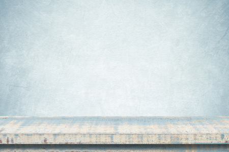 montage: Empty vintage wooden table over blue cement wall background, template, product display montage