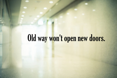 open type font: Inspirational quotation, old way wont open new doors, positive thinking inspiration Stock Photo