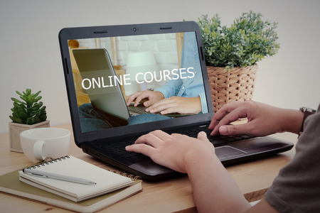 Man hand typing laptop with online courses on screen, e-learning, education and technology, life style Standard-Bild