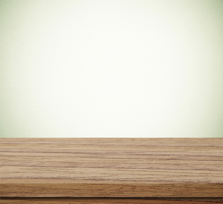 montage: Empty wooden table over blue cement wall  background, for product display montage