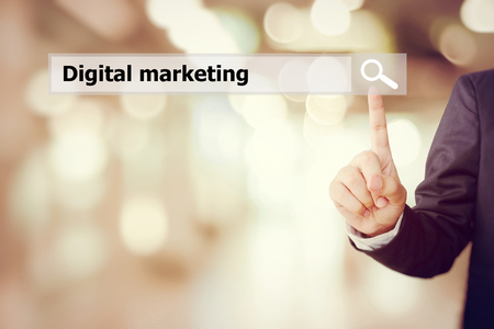 businees: Businessman hand touch search bar with digital marketing word over blur background, digital marketing concept, businees and technology