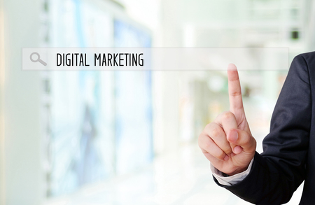 Businessman hand touch search bar with digital marketing word over blur background, digital marketing concept, businees and technology