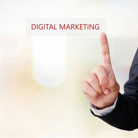 businees: Businessman hand touch digital marketing word over blur background, digital marketing concept, businees and technology