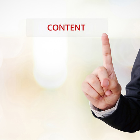 Businessman hand touch content word over blur background, digital marketing concept, businees and technology Stock Photo