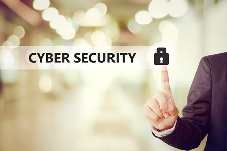 security technology: Businessman pressing key icon over blur background, cyber security concept, business and technology Stock Photo