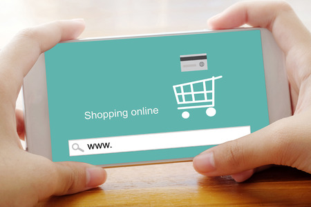 ebuy: Hand holding smart phone with www. on search bar screen background, on line shopping ,business, E-commerce, technology and digital Stock Photo